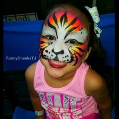 Face painting by FunnyCheeksTJ Dallas Face Painter || Rainbow Tiger  #amazingjakesplano #amazingjakes #DFW #dfwfacepainter #dfwfun  #dfwfacepainting #dfwarea #dfwkids
