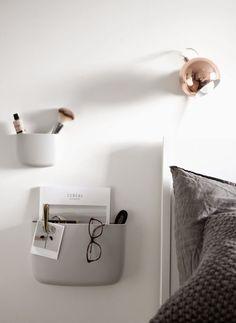 Copper light l Grey wall shelves l White bed l Grey bedding l White, grey and copper bedroom inspiration