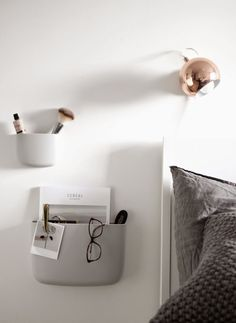 Copper light l Grey wall shelves l White bed l Grey bedding l White, grey and copper bedroom inspiration