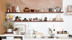 Mitzi kitchen featuring our Kai wall sconce Wall Lights, Wall Sconce Lighting, Interior, Kitchen, Kitchen Dining, Restaurant Interior, Wall Sconces, Kitchen Cabinets, Kitchen Dishes