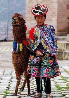 Quechua girl and her lama, Peru