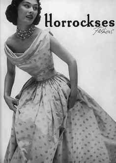 Lovely polka dots and layers of wonderful beaded necklaces.  -Jebus, look at the size of that waist!