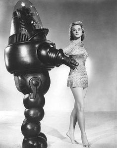 Robbie & Anne Francis of Forbidden Planet fame.  They now live in the non-Martian zone of California where they raise eugenic chickens and have three toasters; one boy, two girls.