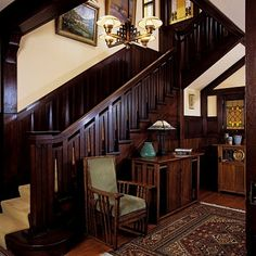 Stairways: Arts & Crafts style,rich wood,the atairs balustrade design is picked up in a table & chair at foot of stairs. Authentic Arts & Craft Accessories abound