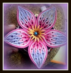 quilling weater coils | The colours used are: White, dark pink, light pink and lavender