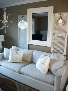Love the shutters and hanging mirrors...NEAT!