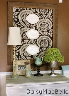 idea to note: cover frame w/ burlap and use white ironstone platters or brown transferware