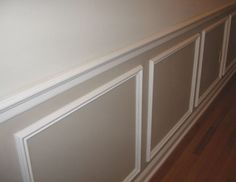 Waistcoat panelling....classic architectural trimmings and chunky skirtings and architraves, so I want to use some timber mouldings to look like wainscot paneling in her entry way, then have all the cabinetry and doors tie in with it