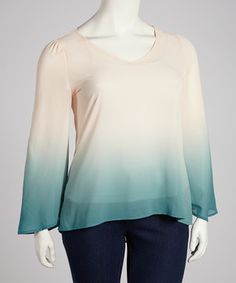 This sheer top features an on-trend ombré design, and the fun doesn't stop there. A hi-low silhouette offers stellar style, while cutouts in back prove the delight is in the details.