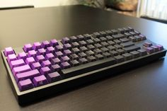 Novatouch TKL with some GeekKeys Purple Ombre side-printed key caps that is simliar to the Limited Edition Novatouch released last year.