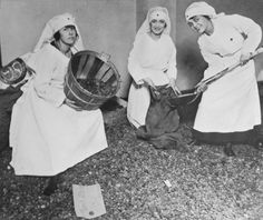 During World War I, three Chicago Red Cross ladies are ankle-deep in peach stones. Seven pounds of pits made the filter for a single gas mask; a million men required masks.