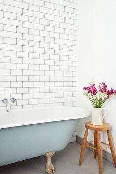 blue tub, classic subway tile in the bathroom