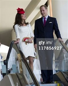 July 1, 2011 - William and Catherine followed by Canadas Governor General David Johnston and his wife Sharon on the escalator as they arrive for the Citizenship Ceremony where they were seated together on stage.