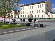 A group enjoys a free EHOD walking tour of Ebrington Barracks in Derry~Londonderry with NIEA Principal Conservation Architect Manus Deery.