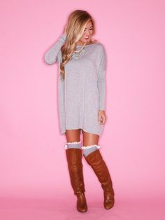 I'm hooked on this outfit! Oversized sweater knee high boots, peak of color and lace from the boot socks