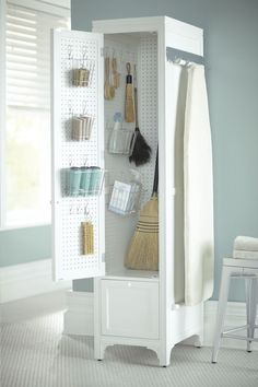 Take control of laundry room chaos! A compact cabinet with pegboards is a great way to store essential cleaning supplies.