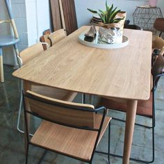 Curious Grace Takahashi 167 Dining Table and Transit Dining Chairs