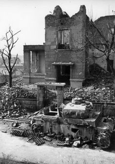 Burnt and dismantled German tank Pz.Kpfw.III the house №19 on the street Tigris (Tigris utca) in Budapest.