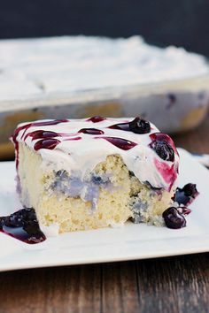 Blueberries and Cream Poke Cake. A delicious and moist white cake filled with blueberries and cream filling and topped with whipped cream.