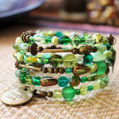 Green and Bronze Beaded Memory Wire spiral wrap bracelet Handcrafted by White Raven Designs RavenshiresRealm