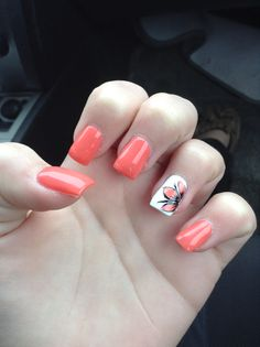 These nails are arcrilics asnd have a coral color on four finger and white on the ring with a flower on the ring finger