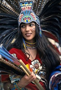 An Aztec dancer in traditional outfits