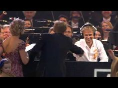 Dutch royal family on podium with Armin van Buuren and RCO.