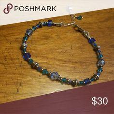 Swarovsky Crystal Bracelet Handmade Blue Swarovsky Crystal Bracelet. Length is 7.5-8.5 inches (adjustable clasp) High Strung Beads by Betty Jewelry Bracelets
