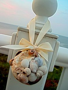 make a beachy kissing ball by glueing shells onto a styraofoam ball. via homestoriesatoz.com