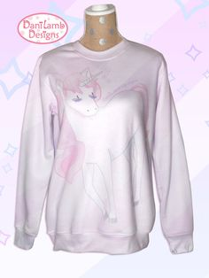 This Unicorn sweater features a cute magical unicorn with a flowing pink mane. She is a pastel dream, full of magic. This lavender unicorn