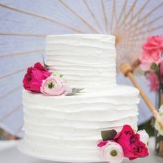 Simple 2 tier buttercream frosting cake with ranunculus and garden roses; Real Wedding: Evelyn Lee and Jerry Vang