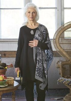 "A beautiful all-silk shawl will keep you wonderfully warm around your neck or over your shoulders. It is also a lovely gift. This delightful creation is printed with the ""Froda"" pattern."