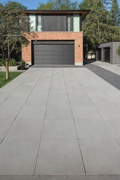 8 Stunning Options for Driveway Pavers. Check out our blog! Driveway Design, Driveway Landscaping, Driveway Pavers, Paver Stones, Garage Doors, Sidewalk, Backyard, Driveways, Landscape