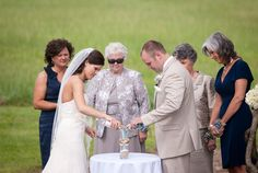 Sand pouring ceremony.  Amber + Michael's wedding at Lenora's Legacy. Image credit: Camilla Calnan Photography.