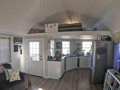 560 SQ FT Home for sale on the Tiny House Marketplace. This custom built home fe Tiny House Living Room Built Custom Home House Marketplace Sale Tiny Tiny House Layout, Shed To Tiny House, Tiny House Storage, Modern Tiny House, D House, Tiny House Cabin, Tiny House Living, Tiny House Plans, Tiny House Design