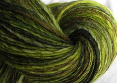 """SheepingBeauty on Etsy. """"Tender Greens"""" single-ply hand-spun yarn from mixed Blue Faced Leicester, hand-dyed by SosaeCaetano on Etsy."""