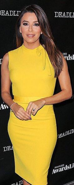 Who made  Eva Longoria's yellow bow dress and nude pumps?