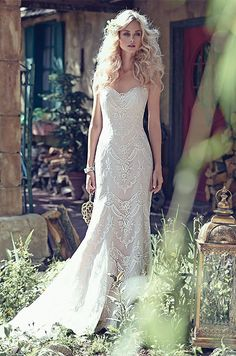 Elegant lace appliqués drift atop tulle to create this breathtaking bohemian sheath wedding dress, with a timeless, romantic sweetheart neckline. Maggie Sottero Spring 2016 wedding dress collection