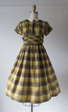 vintage 1950s cotton day dress great brown and yellow plaid pattern and a little white collar ruched around the middle two pieces loop into a plastic