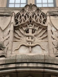 The caduceus is supposed to be Hermes, Angel Art, Illuminati, Cartography, Amazing Architecture, Dungeons And Dragons, Geometry, Lion Sculpture, Spirituality