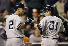 ALDS GAME 1: Sunday, Oct. 7, 2012 - New York Yankees' Derek Jeter, left, and Ichiro Suzuki fist-bump after scoring on a double by Robinson Cano in the ninth inning of Game 1 of the American League division baseball series against the Baltimore Orioles in Baltimore. New York won 7-2.