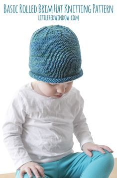 This basic rolled brim baby hat knitting pattern knits up quickly and makes and adorable and classic simple baby hat for newborns, babies and toddlers!