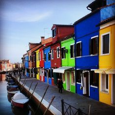 Bright colors make for a bold impact on this  Italian street.  Burano, Italy.