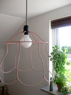 Ghost chandelier lampshade chandeliers lights and lampshades wire frame lampshade trend real simple greentooth Image collections