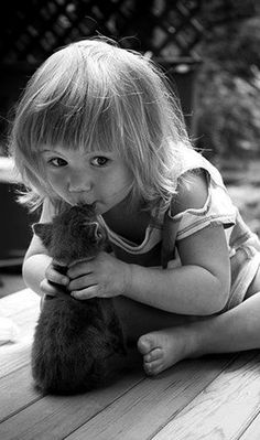 Cute little girl kissing her kitten - crescentmoon b & w (hva)