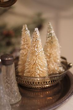 Wonderful little bottle brush trees displayed on a small silver tray.