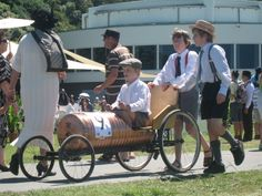 Art Deco Weekend 'Soap Box Derby' Its fantastic too see everyone getting into the spirit! Its like Goodwood without the Racing! A fun event for all the family. Napier New Zealand, Art Deco Clothing, Rise From The Ashes, Art Deco Buildings, Soap Boxes, Fun Events, Wonderful Places, Derby, Spirit