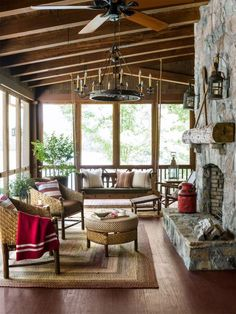 A South Carolina screened-in porch featured in Country Living Magazine. Love this cozy, rustic style for fall!