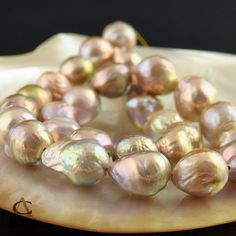 A new and extremely rare pearl is cultured in China. It's an in-body bead-nucleated most colorful rainbow iridescent freshwater pearl.    JUMBO Kasumi-like FRESHWATER PEARL STRAND 28 Multicolor Nucleated Baroque 16.14""