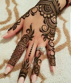 Mehndi henna designs are always searchable by Pakistani women and girls. Women, girls and also kids apply henna on their hands, feet and also on neck to look more gorgeous and traditional. Henna Hand Designs, Eid Mehndi Designs, Mehndi Designs Finger, Pretty Henna Designs, Modern Mehndi Designs, Mehndi Design Pictures, Mehndi Designs For Girls, Beautiful Mehndi Design, Henna Tattoo Designs